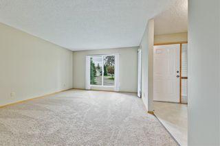 Photo 3: 132 DEER RIDGE Close SE in Calgary: Deer Ridge Semi Detached for sale : MLS®# C4303155