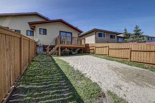 Photo 4: 165 Castlebrook Way NE in Calgary: Castleridge Semi Detached for sale : MLS®# A1107491