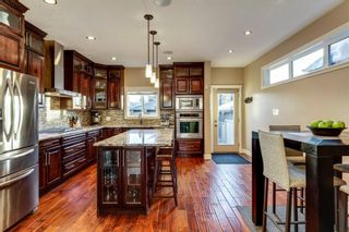 Photo 8: 1110 42 Street SW in Calgary: Rosscarrock Detached for sale : MLS®# A1145307