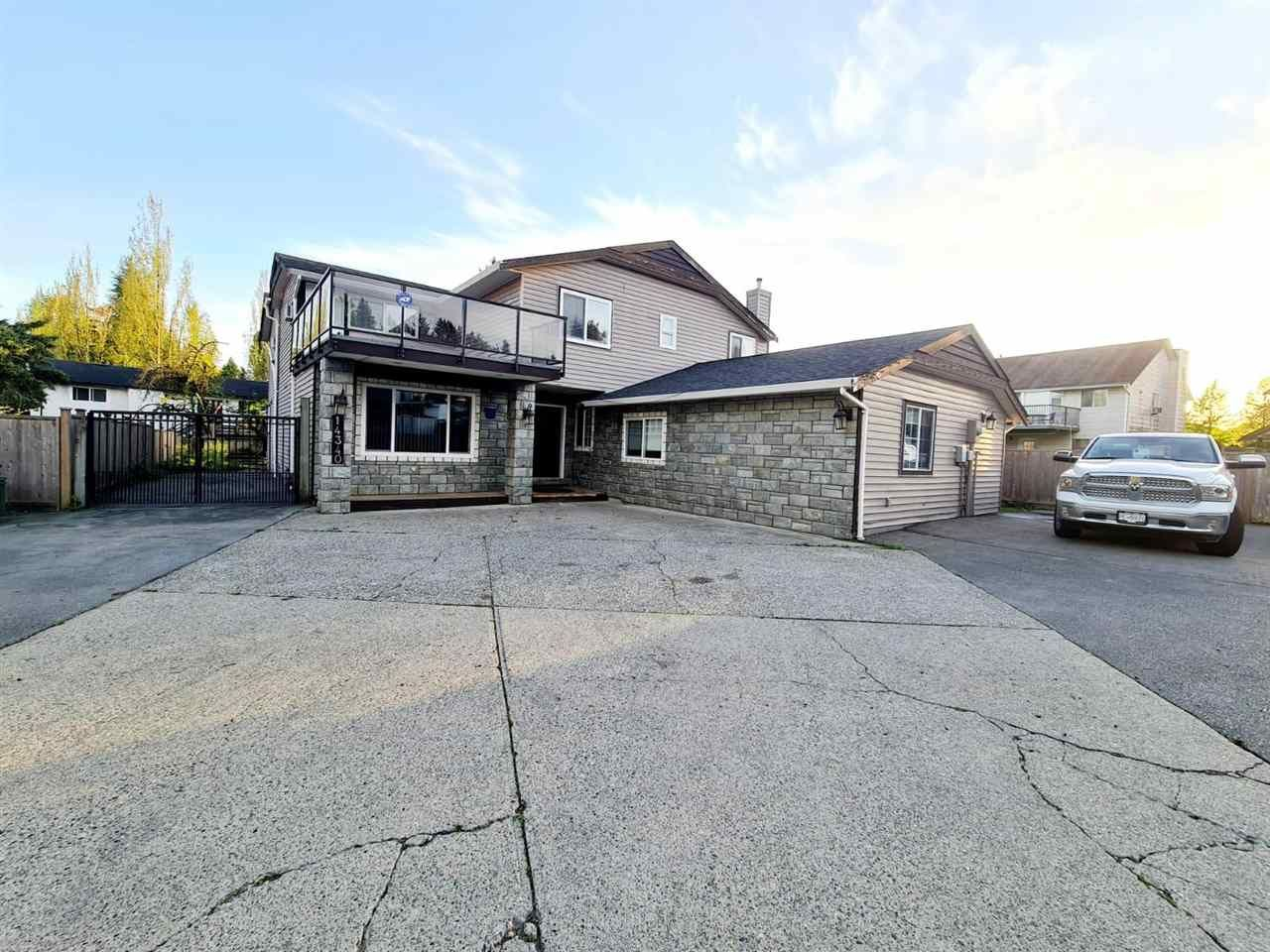 Main Photo: 14340 HYLAND Road in Surrey: East Newton House for sale : MLS®# R2573733