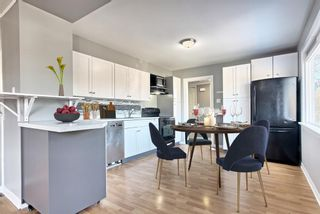 Photo 4: 7943 48 Avenue NW in Calgary: Bowness Detached for sale : MLS®# A1096332