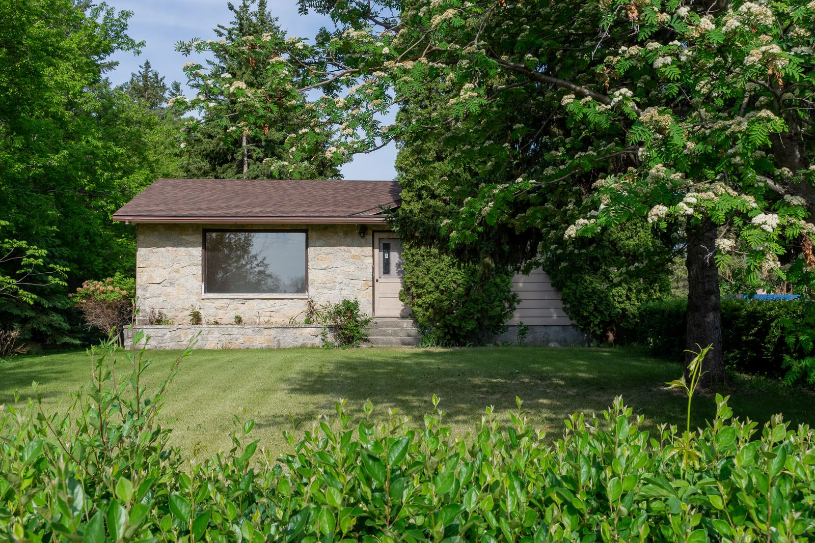 Main Photo: 45 East Road in Portage la Prairie RM: House for sale : MLS®# 202113971