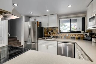 """Photo 8: 916 BRITTON Drive in Port Moody: North Shore Pt Moody Townhouse for sale in """"Woodside Village"""" : MLS®# R2616930"""