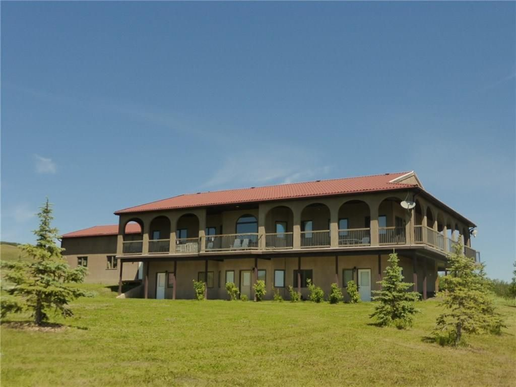 Amazing walk out bungalow situated of the 27 acres in  Foothills County.