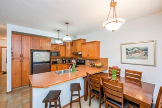 Photo 5: 74 Discovery Heights SW in Calgary: Discovery Ridge Row/Townhouse for sale : MLS®# A1104755