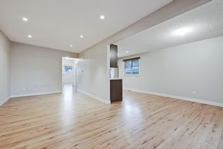 Photo 10: 228 27 Avenue NW in Calgary: Tuxedo Park Semi Detached for sale : MLS®# A1043141