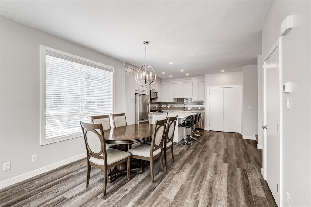 Photo 12: Photos: 125 Redstone Crescent NE in Calgary: Redstone Row/Townhouse for sale : MLS®# A1124721