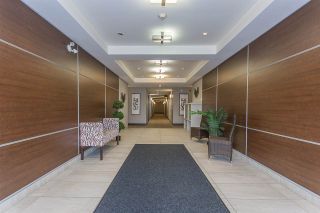 """Photo 1: 403 19936 56 Avenue in Langley: Langley City Condo for sale in """"BEARING POINTE"""" : MLS®# R2236302"""
