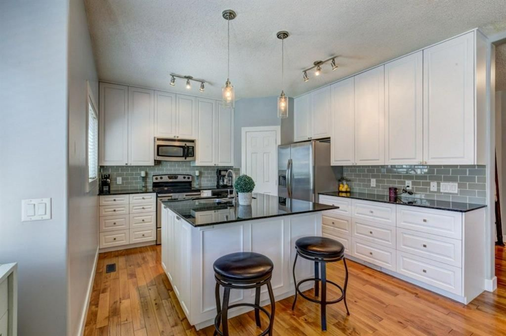 Photo 4: Photos: 1719 Baywater View SW: Airdrie Detached for sale : MLS®# A1124515