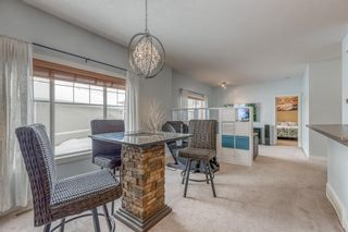 Photo 12: 1401 281 COUGAR RIDGE Drive SW in Calgary: Cougar Ridge Row/Townhouse for sale : MLS®# A1070231