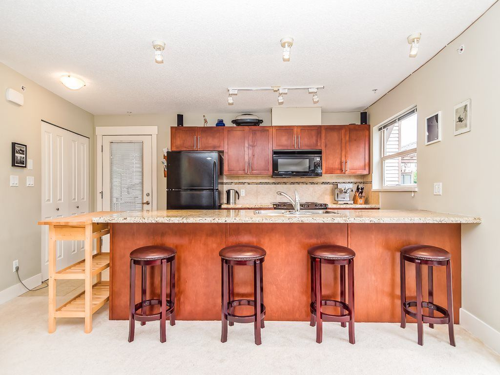 """Main Photo: 205 1174 WINGTIP Place in Squamish: Downtown SQ Condo for sale in """"Talon at Eaglewind"""" : MLS®# R2240739"""