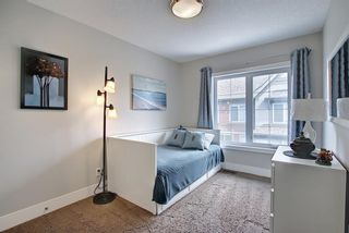 Photo 31: 444 Quarry Way SE in Calgary: Douglasdale/Glen Row/Townhouse for sale : MLS®# A1094767