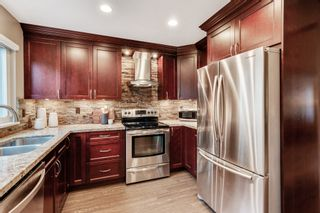 """Photo 10: 8215 STRAUSS Drive in Vancouver: Champlain Heights Townhouse for sale in """"Ashleigh Heights"""" (Vancouver East)  : MLS®# R2565596"""