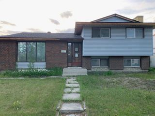 Main Photo: 307 Queensland Drive SE in Calgary: Queensland Detached for sale : MLS®# A1115209