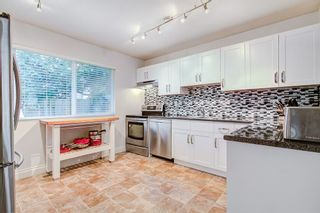 """Photo 3: 1245 BLUFF Drive in Coquitlam: River Springs House for sale in """"River Springs"""" : MLS®# R2357024"""