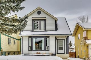Photo 1: 207 STRATHEARN Crescent SW in Calgary: Strathcona Park House for sale : MLS®# C4165815