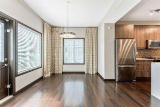 Photo 10: 1015 Evansridge Common NW in Calgary: Evanston Row/Townhouse for sale : MLS®# A1134849