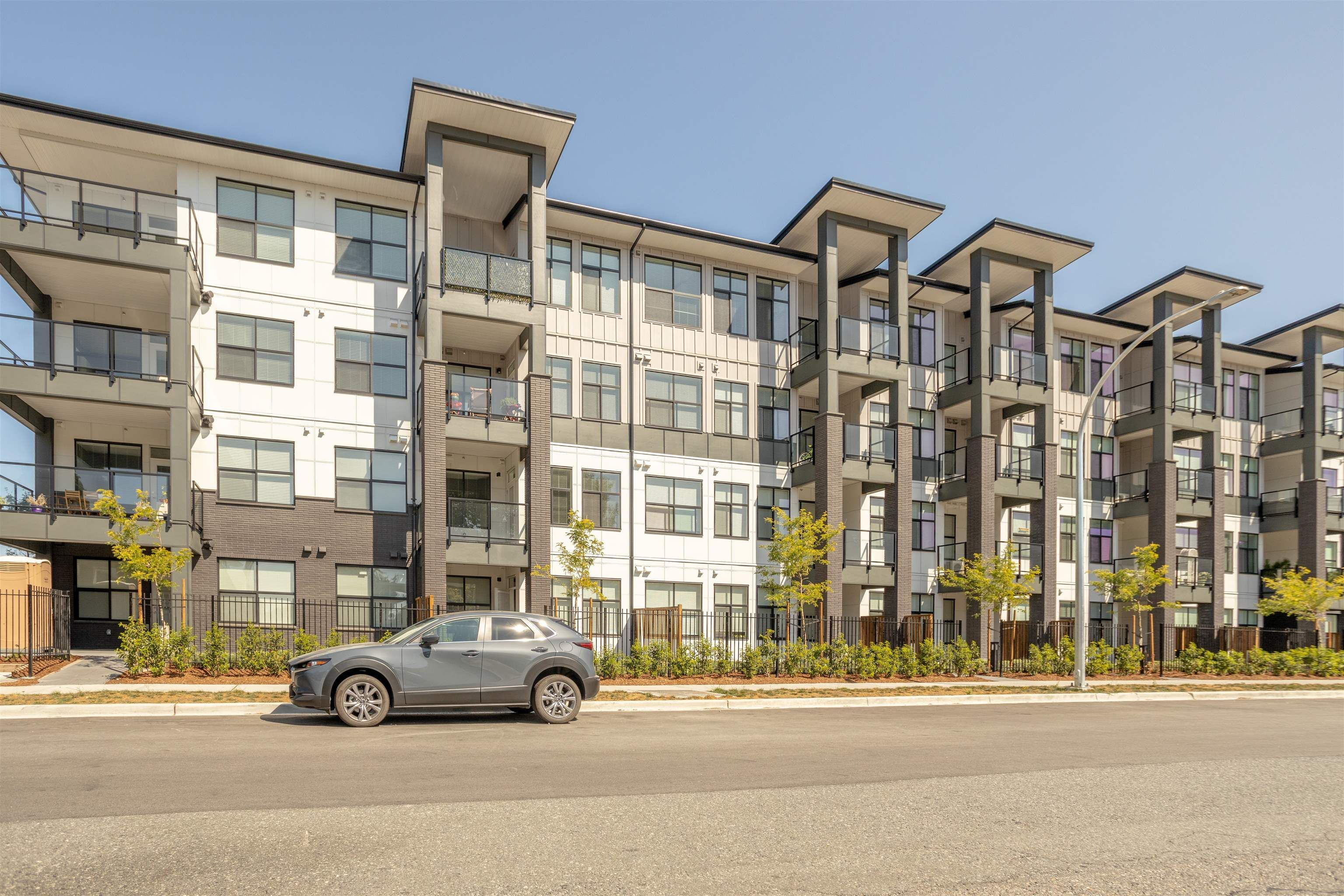 """Main Photo: 406 2120 GLADWIN Road in Abbotsford: Central Abbotsford Condo for sale in """"THE ONYX AT MAHOGANY"""" : MLS®# R2614339"""