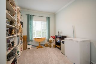 """Photo 18: 411 20281 53A Avenue in Langley: Langley City Condo for sale in """"Gibbons Layne"""" : MLS®# R2621680"""