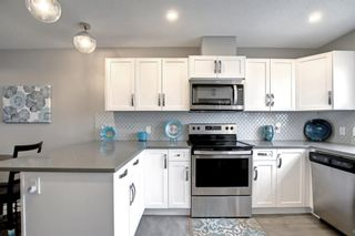Photo 6: 1002 2461 Baysprings Link SW: Airdrie Row/Townhouse for sale : MLS®# A1151958