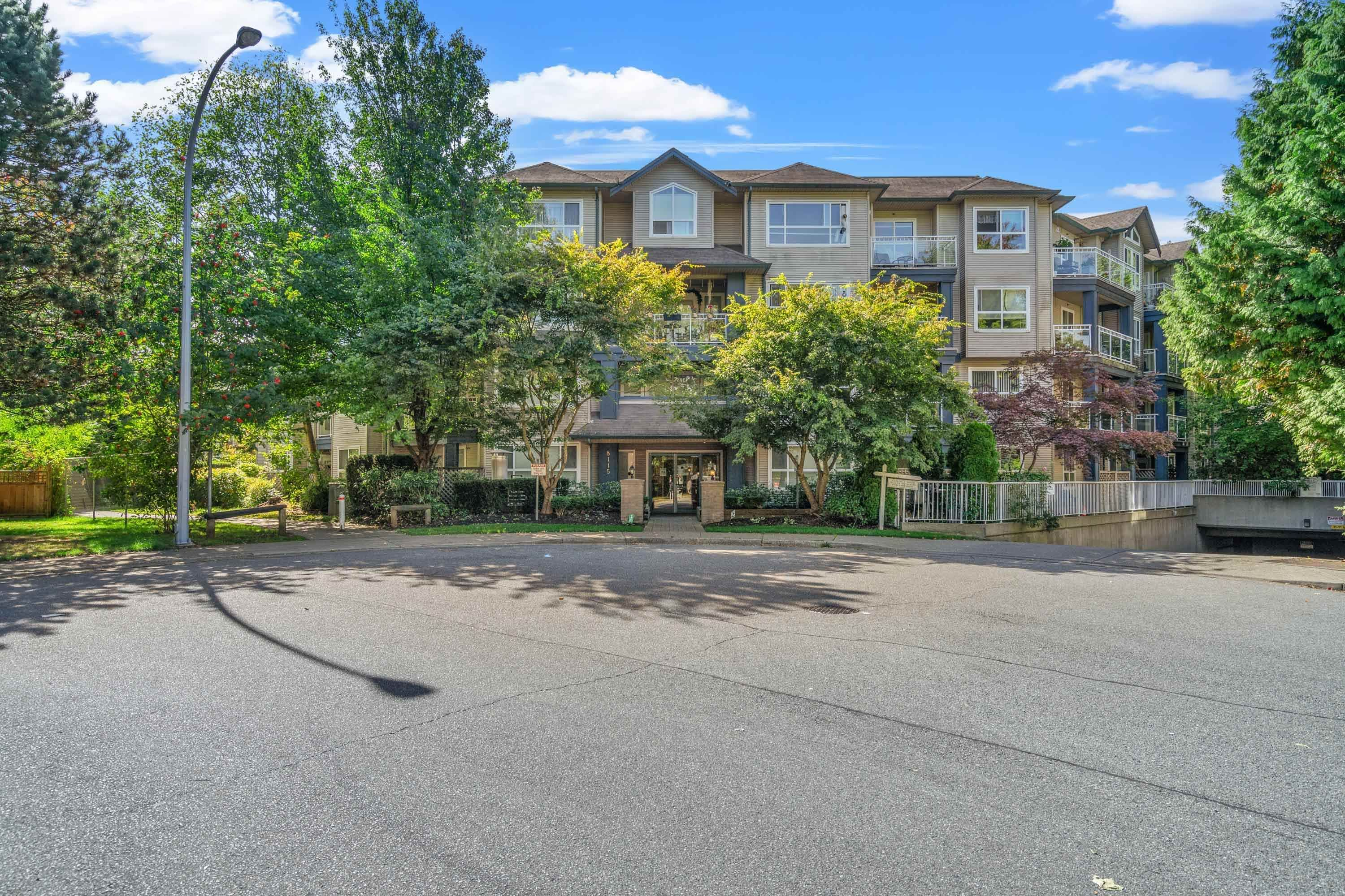 """Main Photo: 409 8115 121A Street in Surrey: Queen Mary Park Surrey Condo for sale in """"The Crossing"""" : MLS®# R2619545"""