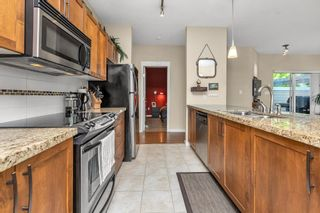 "Photo 12: 206 12350 HARRIS Road in Pitt Meadows: Mid Meadows Condo for sale in ""KEYSTONE"" : MLS®# R2581187"