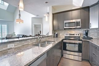 Photo 9: 2407 15 SUNSET Square: Cochrane Apartment for sale : MLS®# A1072593