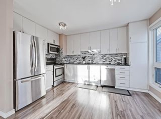 Photo 7: 119 Prominence Heights SW in Calgary: Patterson Row/Townhouse for sale : MLS®# A1070136