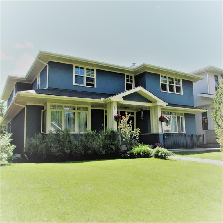 Main Photo: 519 48 Avenue SW in Calgary: Elboya Detached for sale : MLS®# A1088152