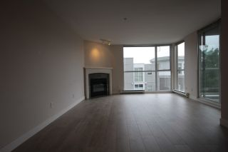 Photo 2: 204 8420 JELLICOE Street in Vancouver: South Marine Condo for sale (Vancouver East)  : MLS®# R2401979
