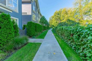 Photo 2: 8 16337 15 Avenue in Surrey: King George Corridor Townhouse for sale (South Surrey White Rock)  : MLS®# R2617341