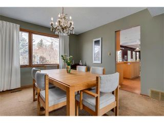 Photo 7: 27 COACHWOOD Place SW in Calgary: Coach Hill House for sale