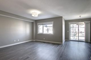 Photo 10: 555 Redstone View NE in Calgary: Redstone Row/Townhouse for sale : MLS®# A1149779