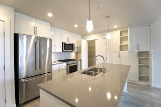 """Photo 4: 601 2565 WARE Street in Abbotsford: Central Abbotsford Condo for sale in """"MILL DISTRICT"""" : MLS®# R2440722"""