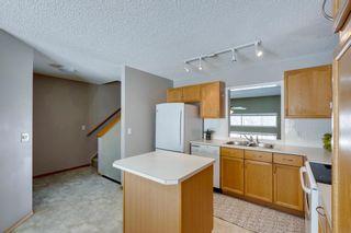 Photo 12: 105 Rocky Ridge Court NW in Calgary: Rocky Ridge Row/Townhouse for sale : MLS®# A1069587