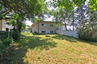 Photo 2: 404 28 Avenue NE in Calgary: Winston Heights/Mountview Semi Detached for sale : MLS®# A1117362