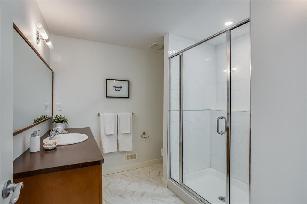 Photo 32: Photos: 219 Somme Manor SW in Calgary: Garrison Woods Detached for sale : MLS®# A1041747