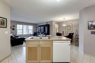 Photo 12: 104 3 EVERRIDGE Square SW in Calgary: Evergreen Row/Townhouse for sale : MLS®# A1143635