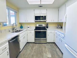 Photo 7: RANCHO BERNARDO Condo for sale : 2 bedrooms : 12439 Meandro Rd in San Diego