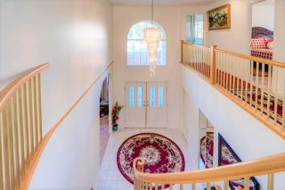 Photo 2: 8203 152 Street in Surrey: Bear Creek Green Timbers House for sale : MLS®# R2443253