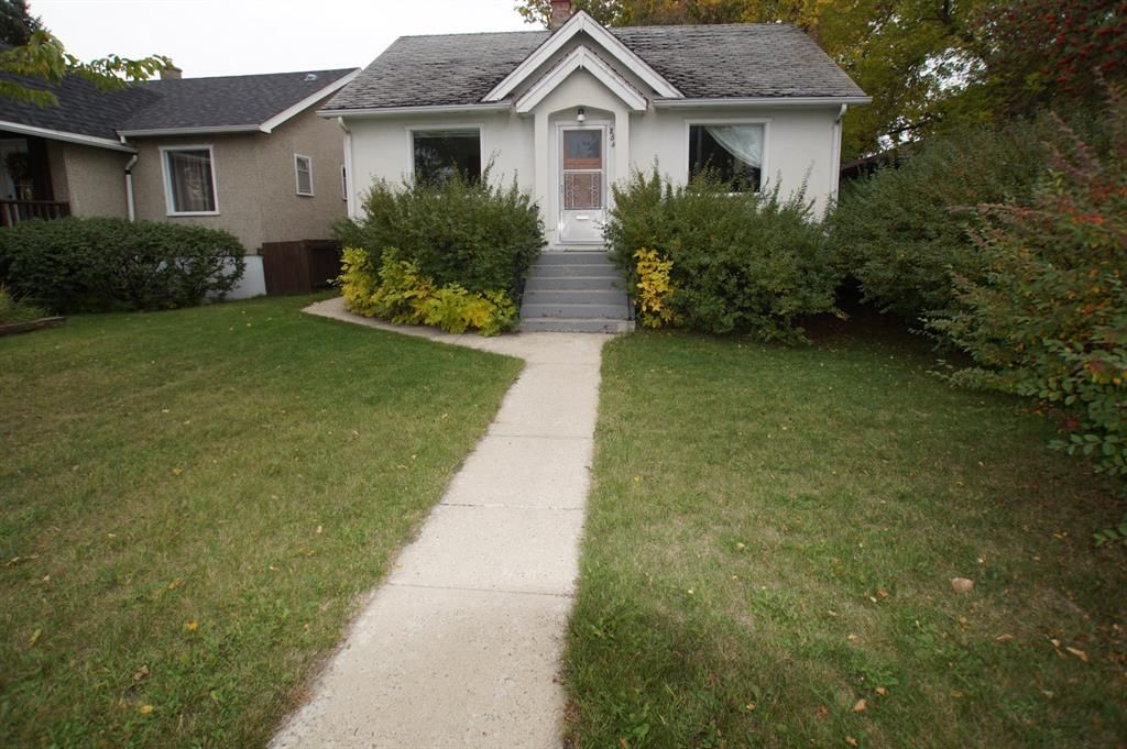 Main Photo: 253 22 Avenue NW in Calgary: Tuxedo Park Detached for sale : MLS®# A1148235