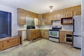 Photo 13: 132 Woodglen Way SW in Calgary: Woodbine Detached for sale : MLS®# A1134338