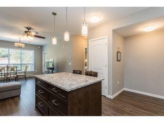 """Photo 4: 210 6490 194 Street in Surrey: Clayton Condo for sale in """"WATERSTONE ESPLANADE GRANDE"""" (Cloverdale)  : MLS®# R2603405"""