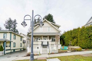 "Photo 2: 105 218 BEGIN Street in Coquitlam: Maillardville Townhouse for sale in ""BEGIN SQUARE"" : MLS®# R2545847"