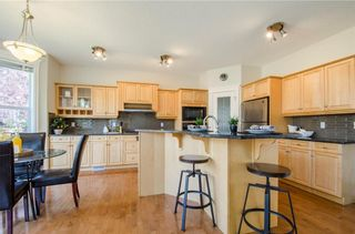 Photo 11: 152 STRATHLEA Place SW in Calgary: Strathcona Park House for sale : MLS®# C4130863