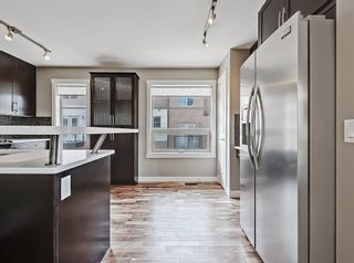 Photo 13: 27 Aspen Hills Common SW in Calgary: Aspen Woods Row/Townhouse for sale : MLS®# A1134206