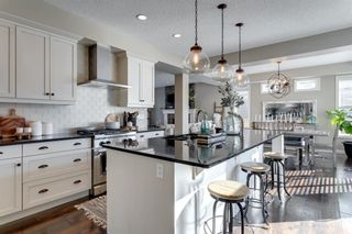Main Photo: 8215 9 Avenue SW in Calgary: West Springs Detached for sale : MLS®# A1081882