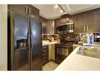 Photo 1: 310 1 Street SE in Calgary: Single Level Apartment for sale : MLS®# C3548056