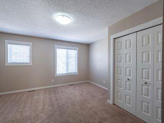 Photo 11: 70 Auburn Bay Link SE in Calgary: Auburn Bay Row/Townhouse for sale : MLS®# A1102367