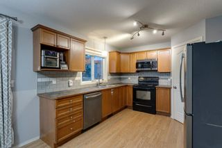 Photo 9: 704 Luxstone Square SW: Airdrie Detached for sale : MLS®# A1133096